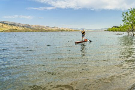 paddling stand up paddleboard on mountain lake in COlorado, summer scenery at Horsetooth Reservoir near Fort Collins photo