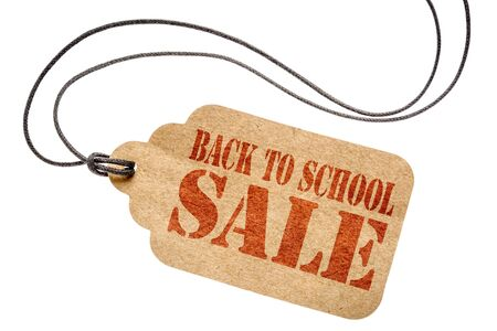 back to school  sale sign  - a paper price tag with twine isolated on white- shopping concept