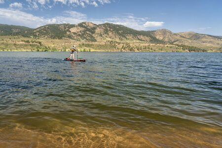 summer recreation on Horsetooth Reservoir in northern Colorado - paddling stand up paddleboard photo