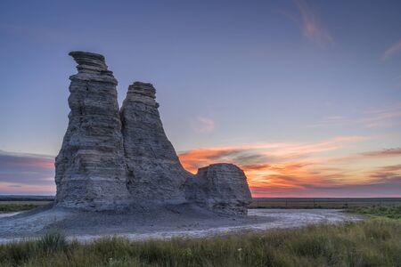 Castle Rock against sunrise - limestone pillar landmark in prairie of western Kansas near Quinter (Gove County) , late summer morning