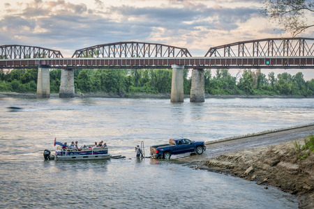 Glasgow, MO, USA - August 13, 2017: Motor boat is being loaded on trailer at a boat ramp after Sunday recreation on the Missouri River. Editorial