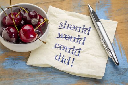 Should, would, could, did! A motivational concept - handwriting on a napkin with a bowl of cherries