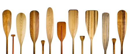 blades and grips of  wooden canoe paddles, a variety of styles and shapes - paddling concept