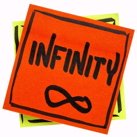 infinity word and symbol - handwriting on an isolated sticky note