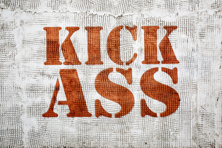 kick ass - red  graffiti sign on a stucco wall
