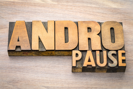 andropause - male menopause - abstract n vintage wood letterpress printing blocks against grained wood
