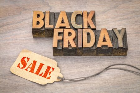 Black Friday sale banner  in vintage letterpress wood type blocks with a price tag against grained wood Stock Photo