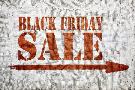 Black Friday sale - graffiti sign on stucco wall