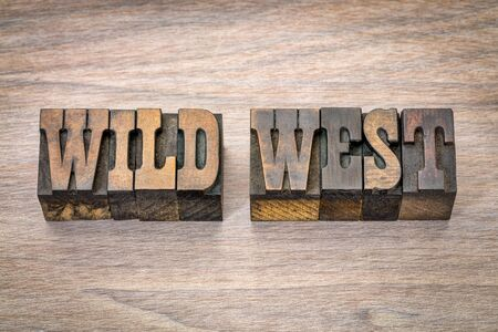 wild west banner - text in vintage letterpress wood type - French Clarendon font popular in western movies and memorabilia