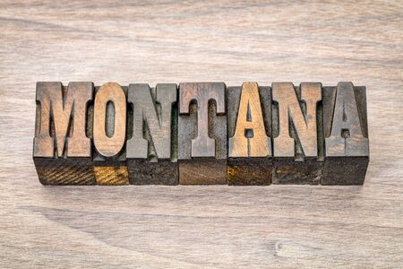 Montana -  word in vintage rustic letterpress wood type - French Clarendon font popular in western movies and memorabilia Stock Photo