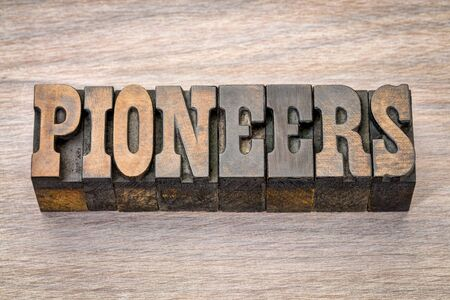 pioneers banner - text in vintage letterpress wood type - French Clarendon font popular in western movies and memorabilia