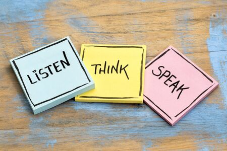 listen, think, speak - communication concept - handwriting in black ink on sticky notes against rustic wood