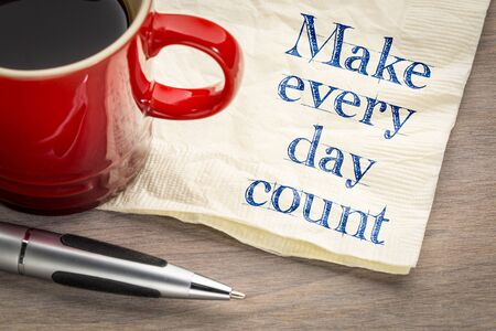 Make every day count - inspirational handwriting on a napkin with a cup of coffee