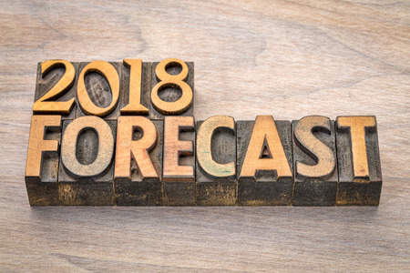 2018 forecast  word abstract in vintage  letterpress wood type against grained wood