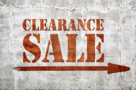 clearance sale - graffiti sign with arrow on stucco wall
