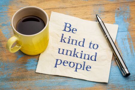 Be kind to unkind people - inspirational handwriting on a napkin with a cup of espresso coffee Stock Photo