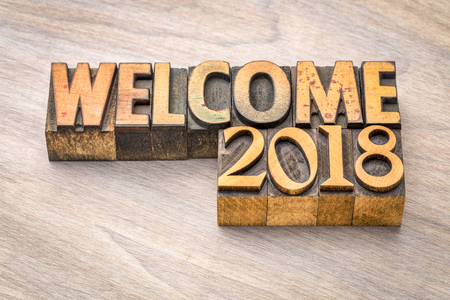 Welcome 2018 - banner in vintage letterpress wood type printing blocks, New Year concept