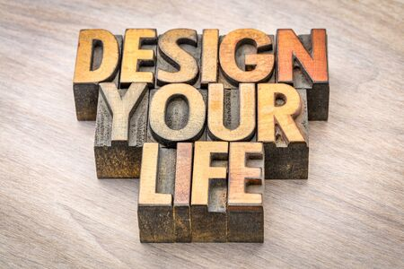 design your life - self development concept - word abstract in vintage letterpress wood type printing blocks