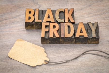 Black Friday concept  in vintage letterpress wood type blocks with a blank price tag against grained wood Stock Photo