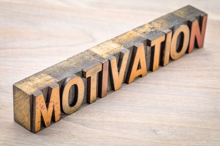 motivation word abstract in vintage letterpress wood type against grained wood Stock Photo