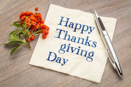 Happy Thanksgiving Day - handwriting on a napkin with firethorn berries