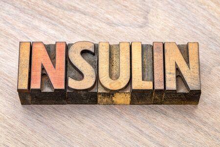 insulin word abstract in vintage letterpress wood type against grained wood Stock fotó