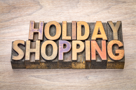 holiday shopping word abstract in vintage letterpress wood type Stock Photo