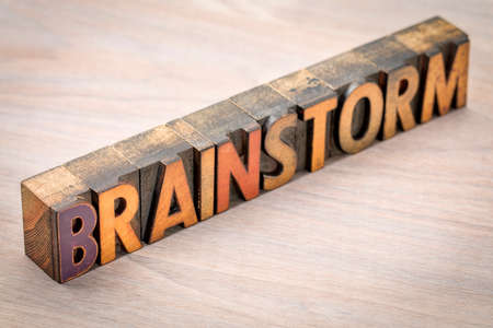 brainstorm word  abstract in vintage letterpress wood type blocks against grained wood Stock Photo