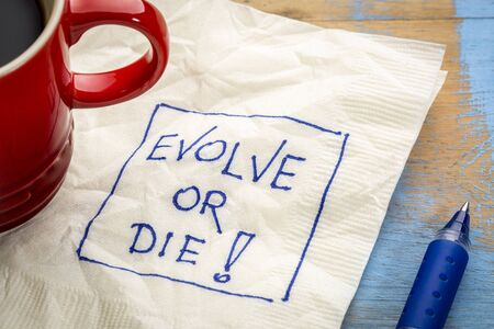 Evolve or die napkin doodle with a cup of coffee Stock fotó