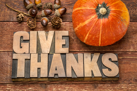 give thanks - Thanksgiving concept - word abstract in  letterpress wood type printing blocks with winter squash and acorn decoration