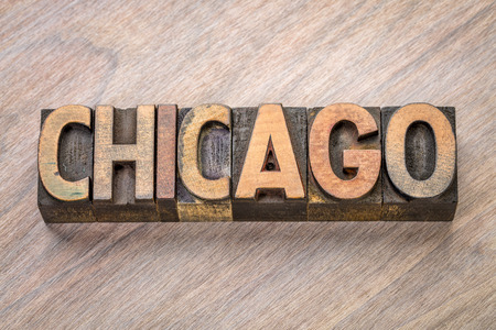Chicago word abstract in vintage  letterpress wood type against grained wooden background