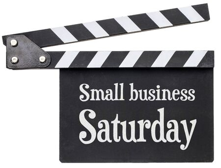 Small business Saturday tile in white chalk on clapboard isolated on white