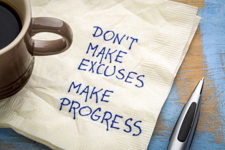 Don't make excuses, make progress - inspirational handwriting on a napkin with a cup of coffee