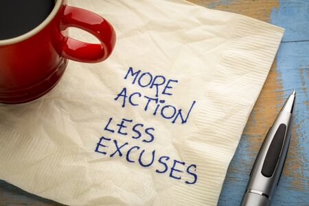 More action, less excuses - handwriting on a napkin with a cup of coffee Stock Photo
