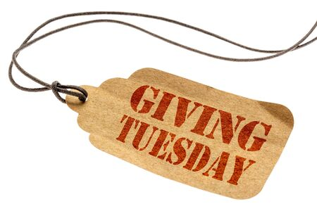 Giving Tuesday sign - a paper price tag with a twine isolated on white