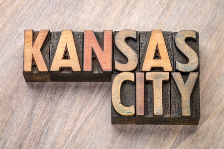 Kansas City word abstract in vintage  letterpress wood type against grained wooden background