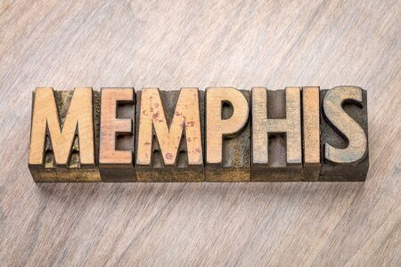 Memphis word abstract in vintage  letterpress wood type against grained wooden background Stock Photo