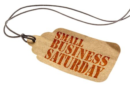 Small Business Saturday sign - a paper price tag with a twine isolated on white Фото со стока - 87897764