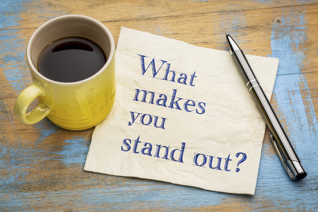 What make you stand out? Handwriting on a napkin with a cup of espresso coffee