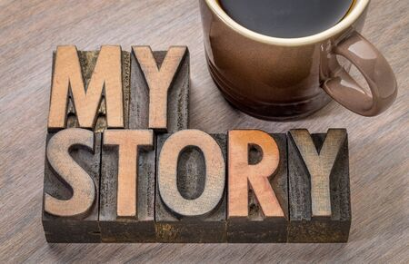 my story word abstract in vintage letterpress wood type with a cup of coffee Reklamní fotografie