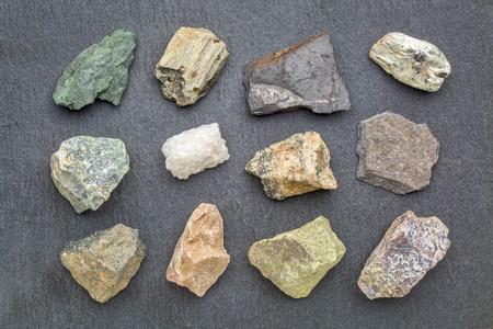 metamorphic  rock geology collection, from top left: chlorite schist, garnet schist, graphite schist, mica schist, serpentinite, marble, gneiss, slate, amphibolite, dolomitic marble, epidosite, quartzite Stock Photo