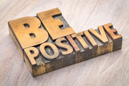 Be positive word abstract in vintage letterpress wood type