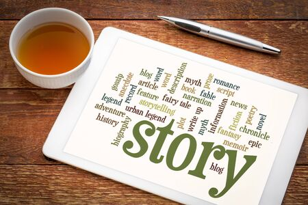 cloud of words or tags related to story, myth and legend on a  digital tablet with a cup of tea
