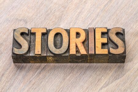 stories word  abstract in vintage letterpress wood type blocks Banco de Imagens
