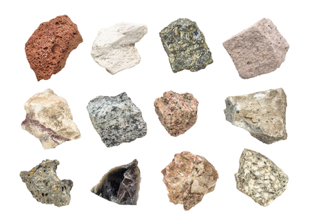 isolated igneous rock geology collection including from top left: scoria, pumice, gabbro, tuff, rhyolite, diorite, granite, andesite, basalt, obsidian,  pegmatite, porphyry Stockfoto