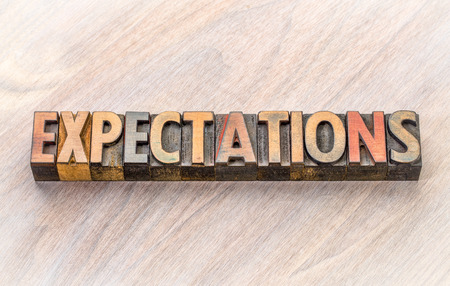 expectations word abstract in vintage letterpress wood type