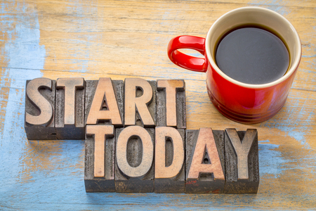 start today  word abstract in vintage letterpress  wood type with a cup of coffee 写真素材