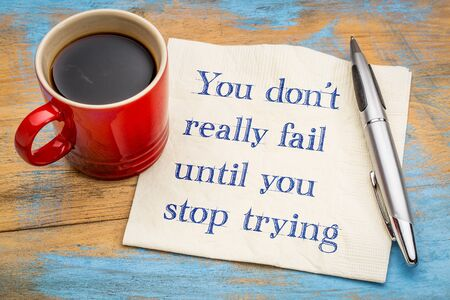 You do not really fail until you stop trying - inspirational handwriting on a napkin with a cup of coffee Imagens