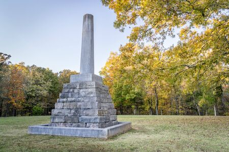 Natchez Trace Parkway, TN, USA - October 29, 2017: Meriwether Lewis Monument and grave at milepost 385.9, fall scenery.