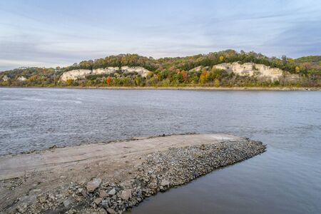 Missouri River near Rocheport, MO (Taylors Landing), old boat ramp and Katy Trail under high cliff - aerial view in late October evening